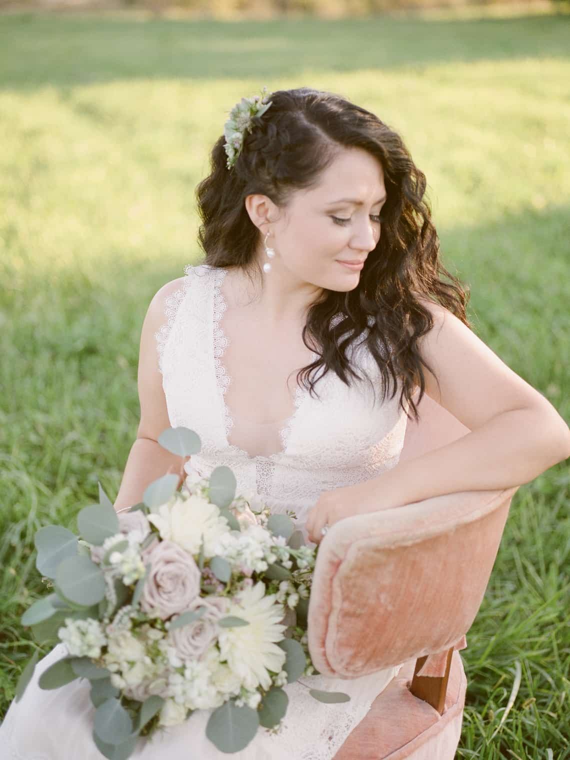 Bride Sitting with Bouquet in Chair
