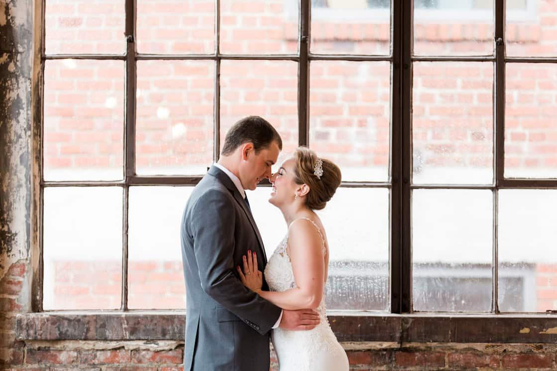 Bride and Groom in Front of Windows