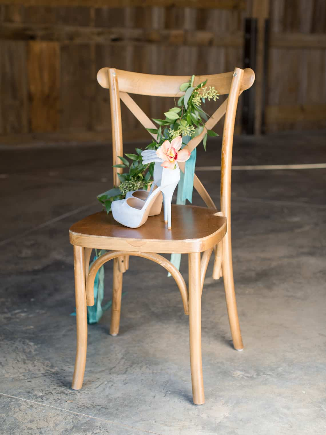 Light Blue Heels with Flower on the Ankle Sitting on a Chair