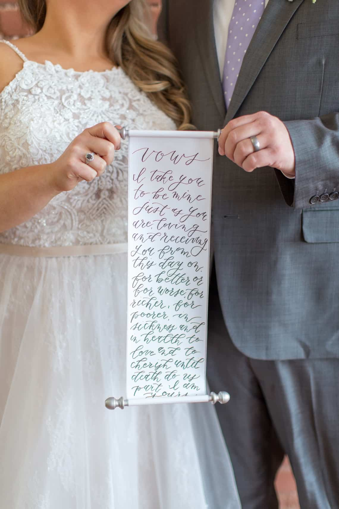 Bride and Groom Holding Scroll with Hand Written Wedding Vows