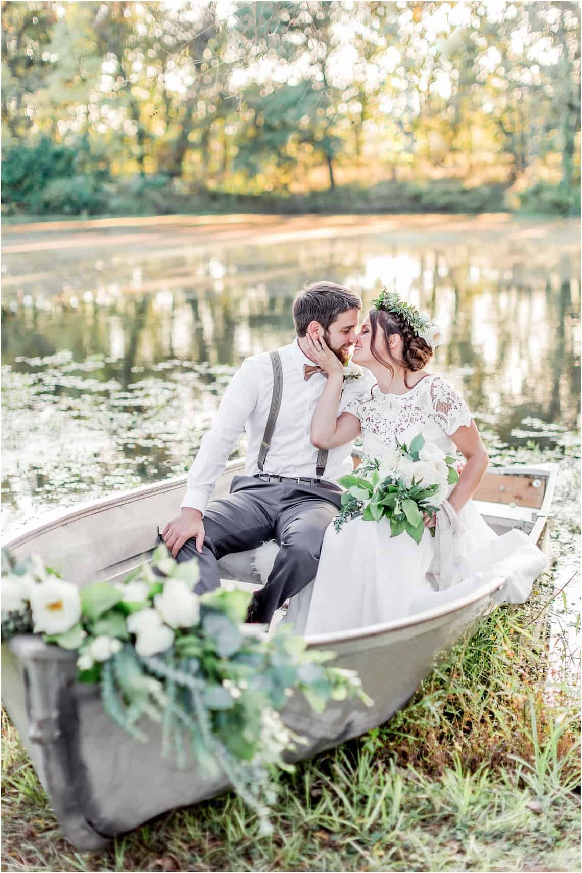 Bride and Groom Snuggling in a Boat on a Lake