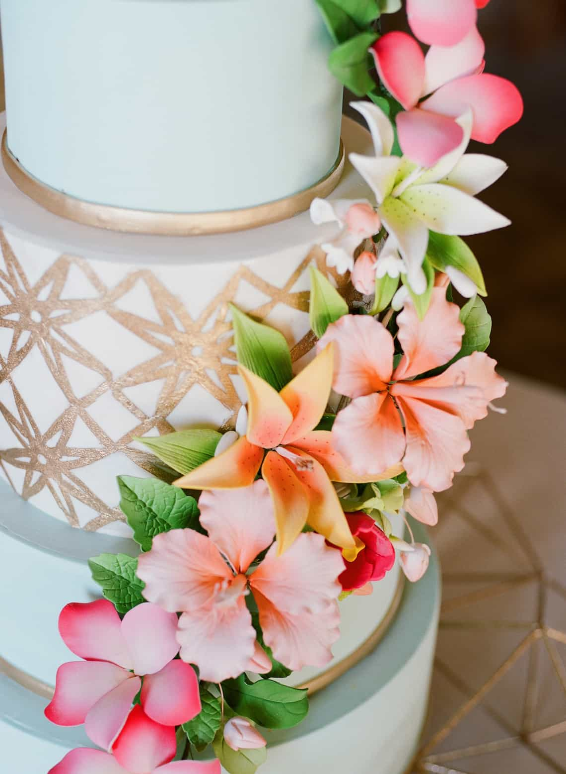 Light Blue Wedding Cake with Gold Geometric Pattern and Tropical Flowers