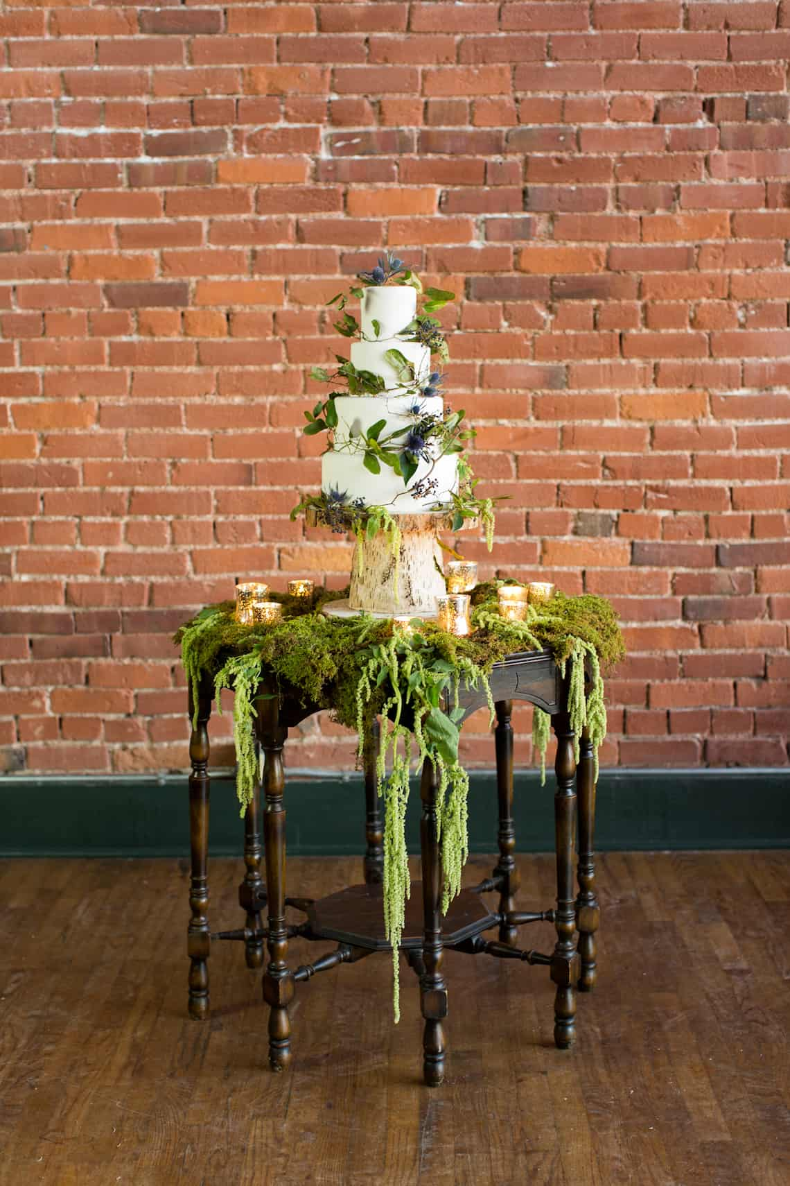 Moss Wedding Cake Table with White Wedding Cake and Birch Cake Stand