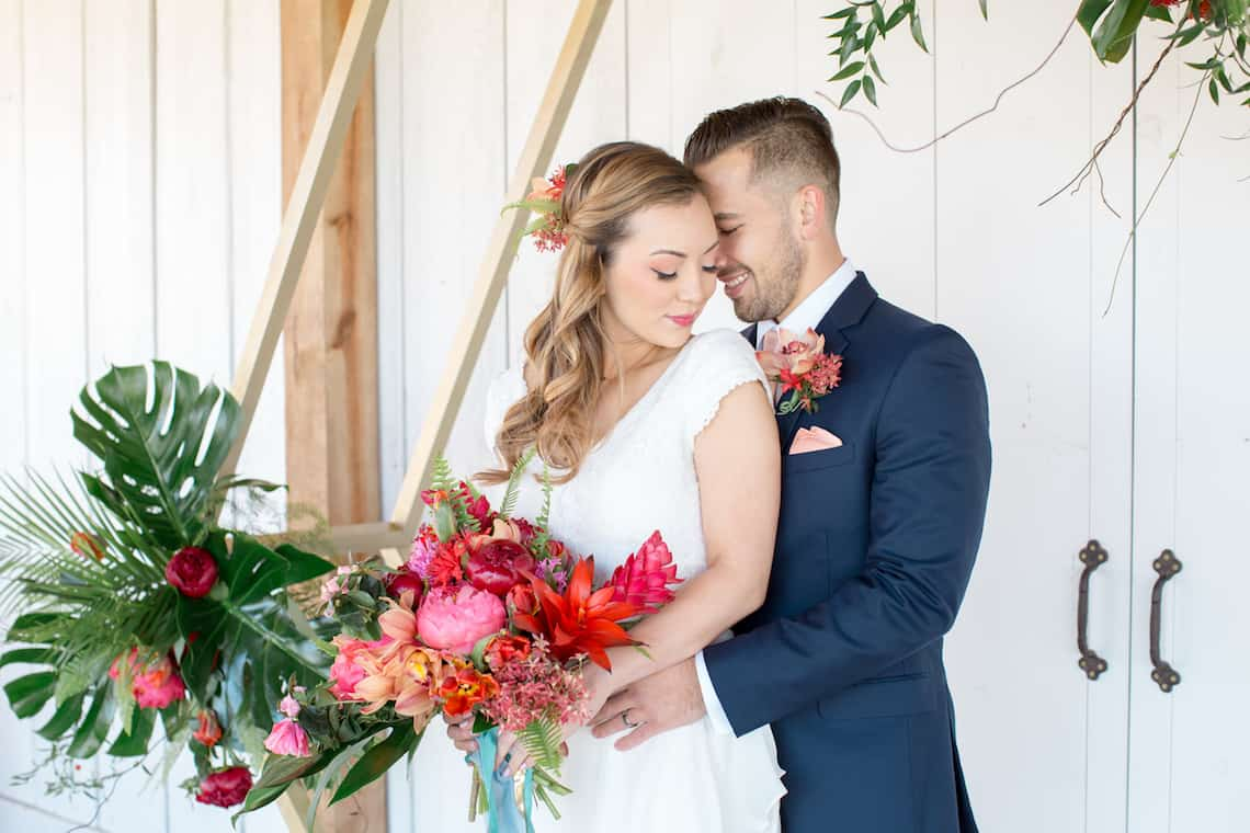 Snuggling Newlyweds with Tropical Flowers