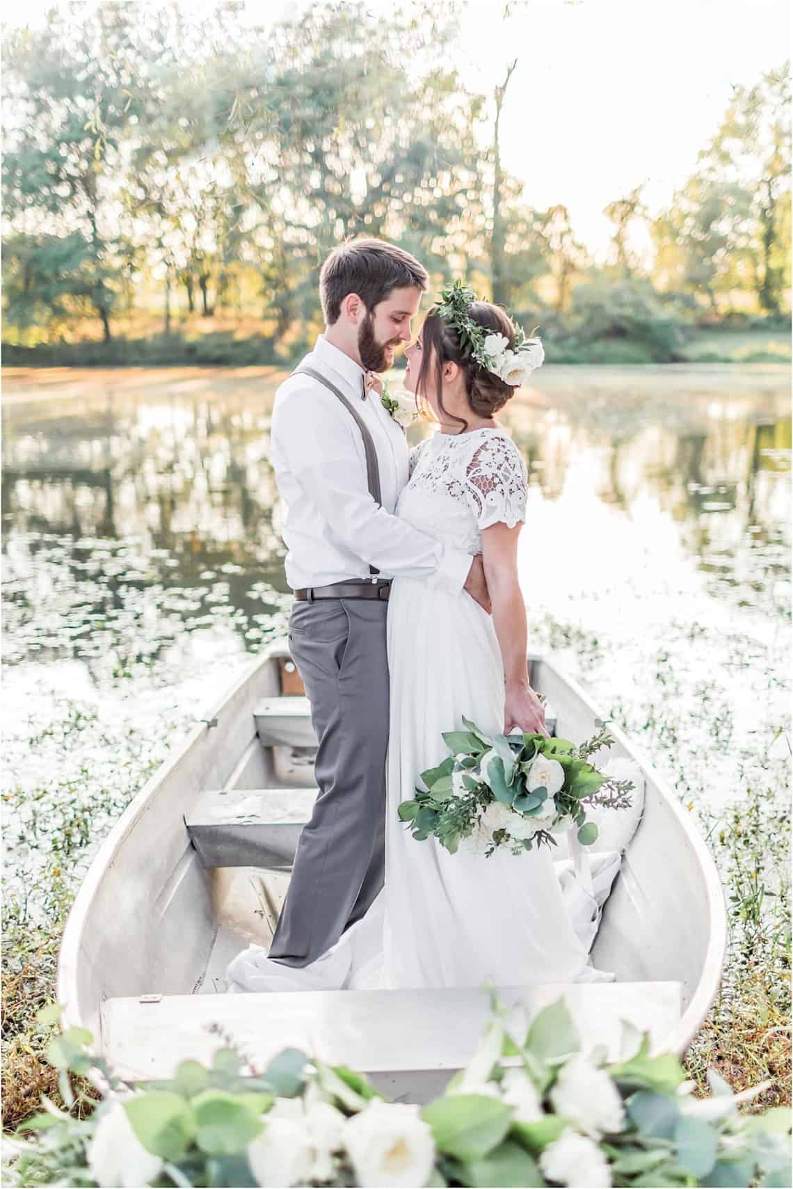 Bride and Groom Standing in a Boat on a Lake