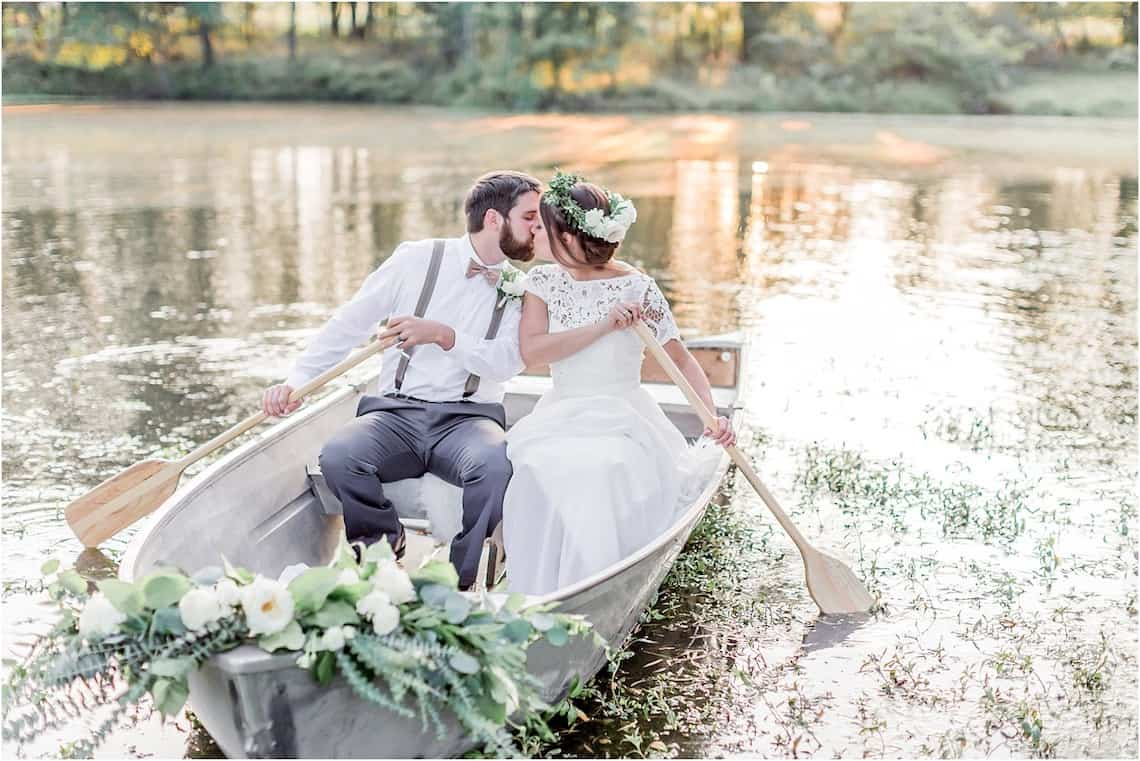 Bride and Groom Kissing in a Small Boat on the Lake