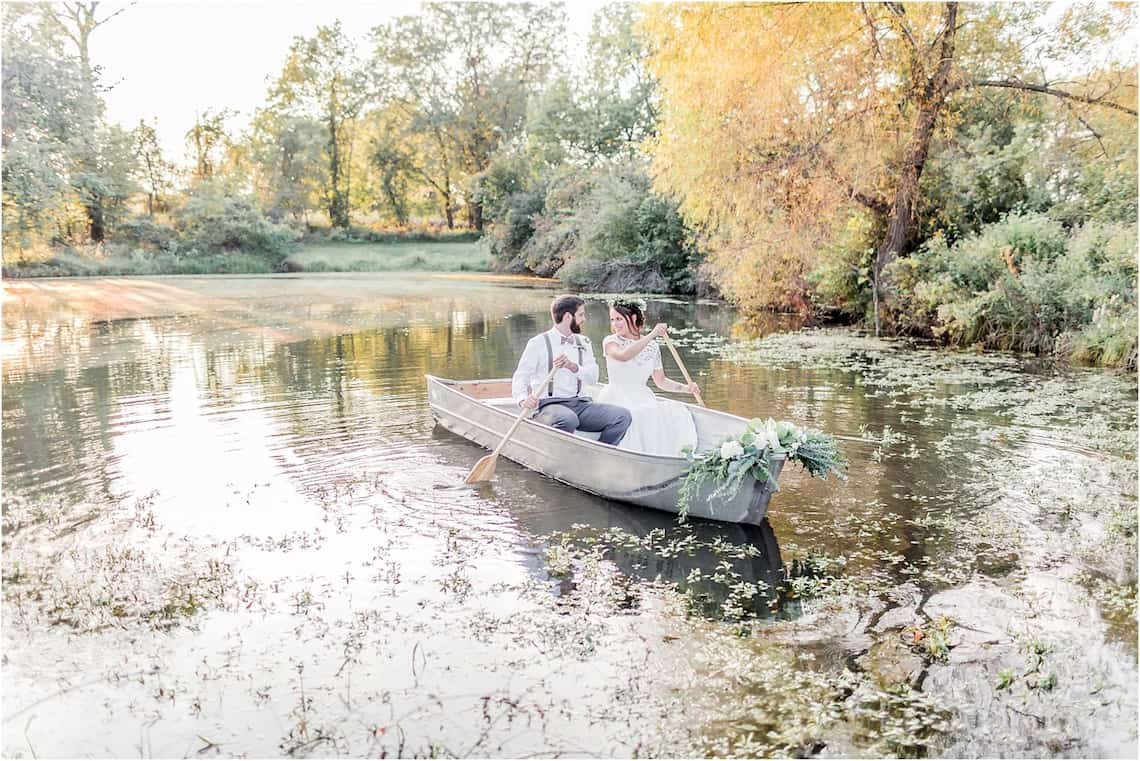 Bride and Groom Rowing in Boat on a Lake