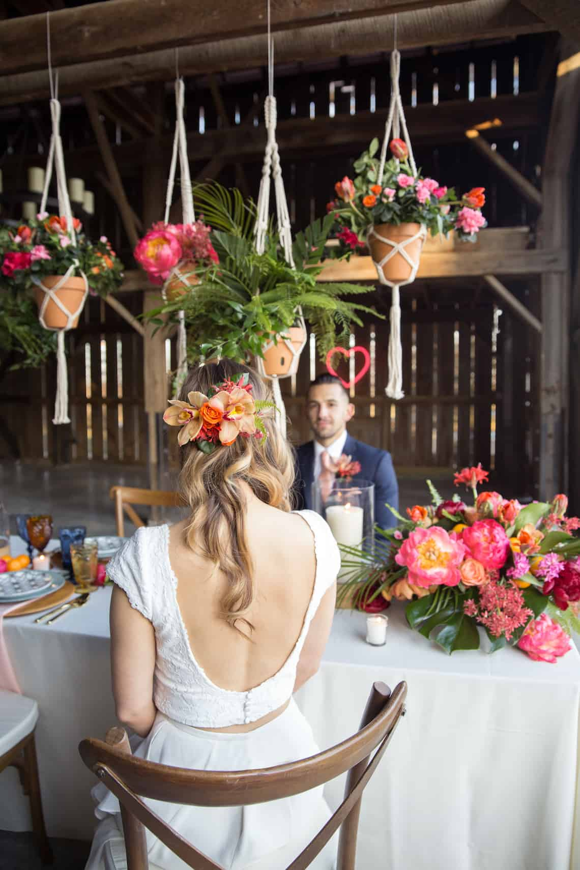 Floral Hairpiece for Bride Sitting Across Table from Groom