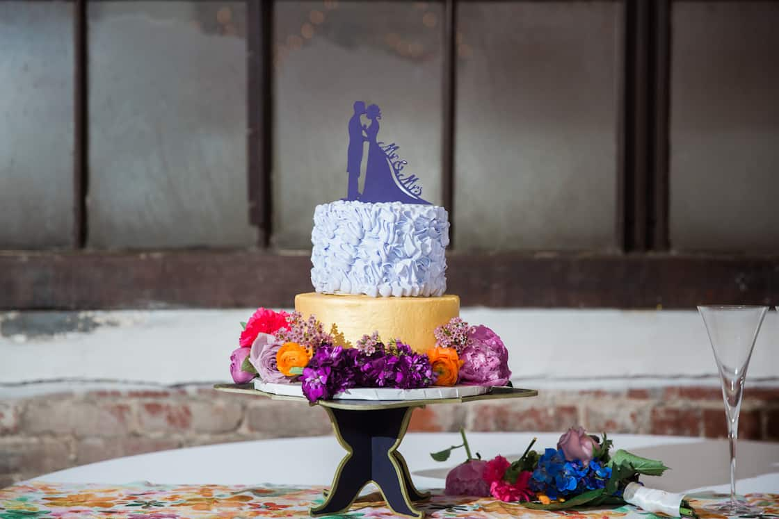 Wedding Cake with Colorful Flowers and Custom Cake Topper