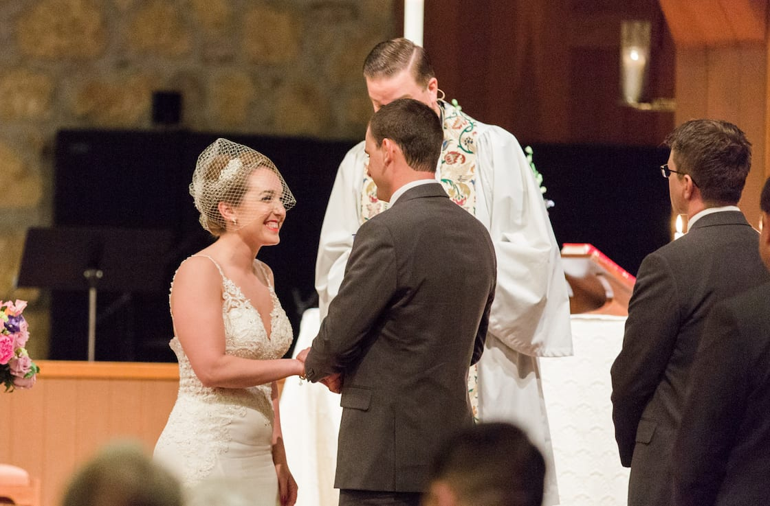 Wedding Ceremony in Church with Bride Laughing