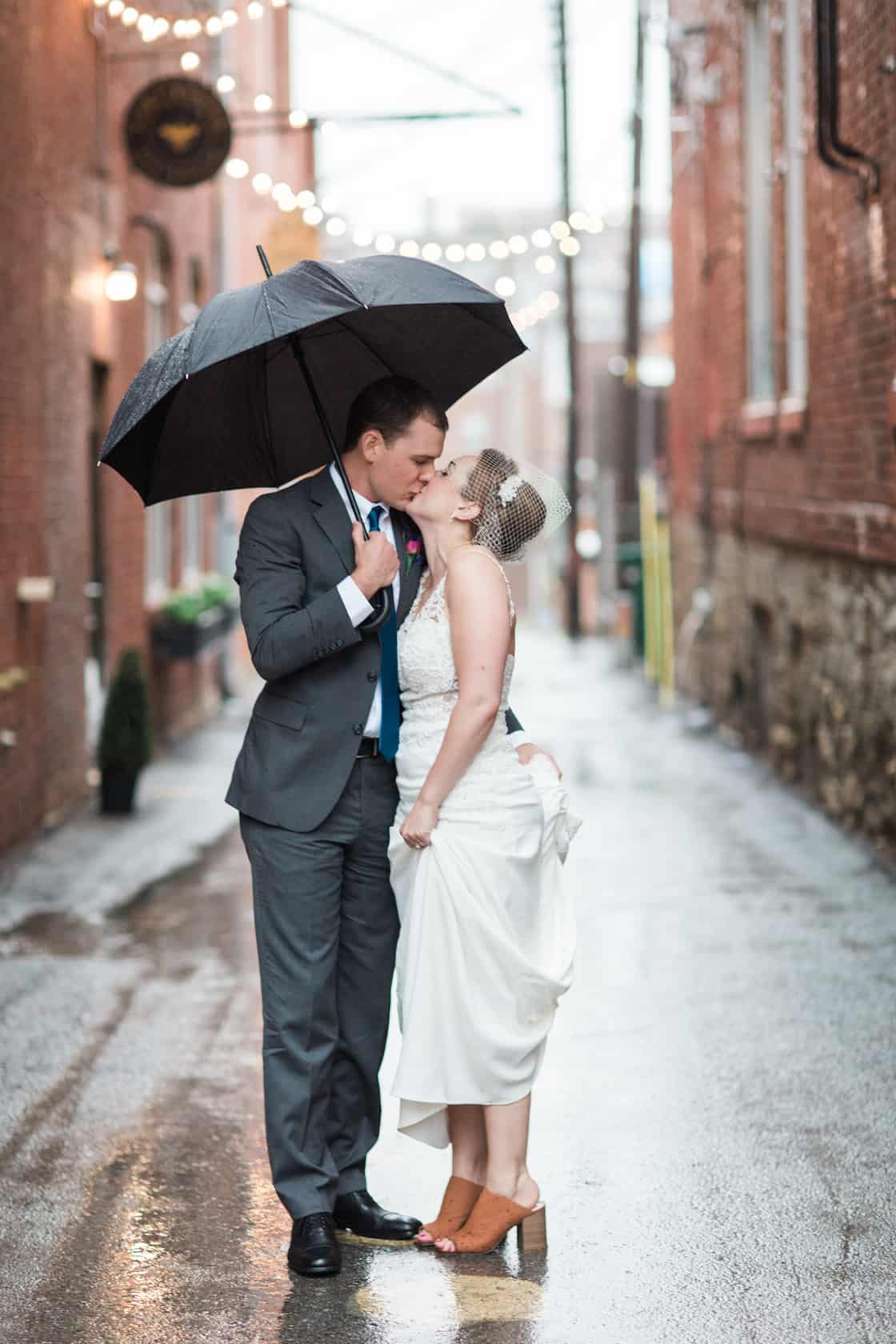 Wedding Couple Kissing in Ally with Umbrella in Kansas City