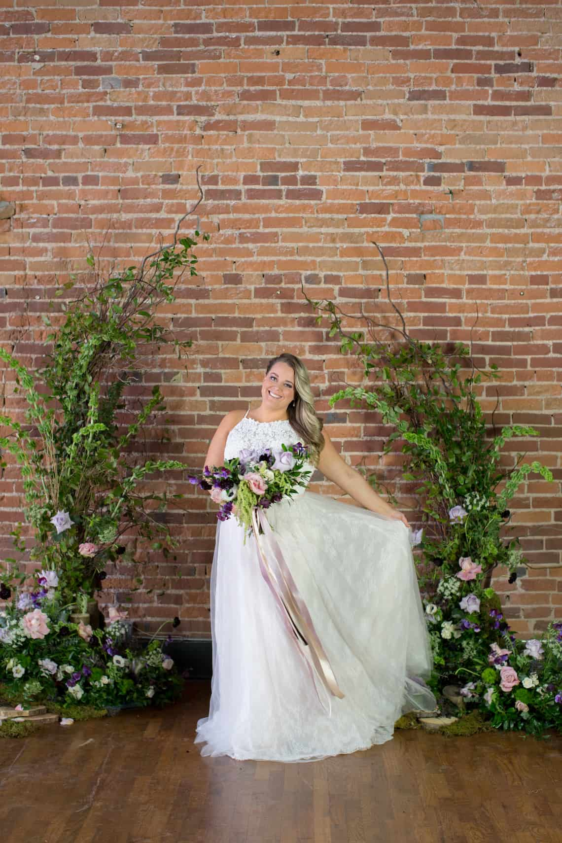 Bride Holding Dress and Bouquet