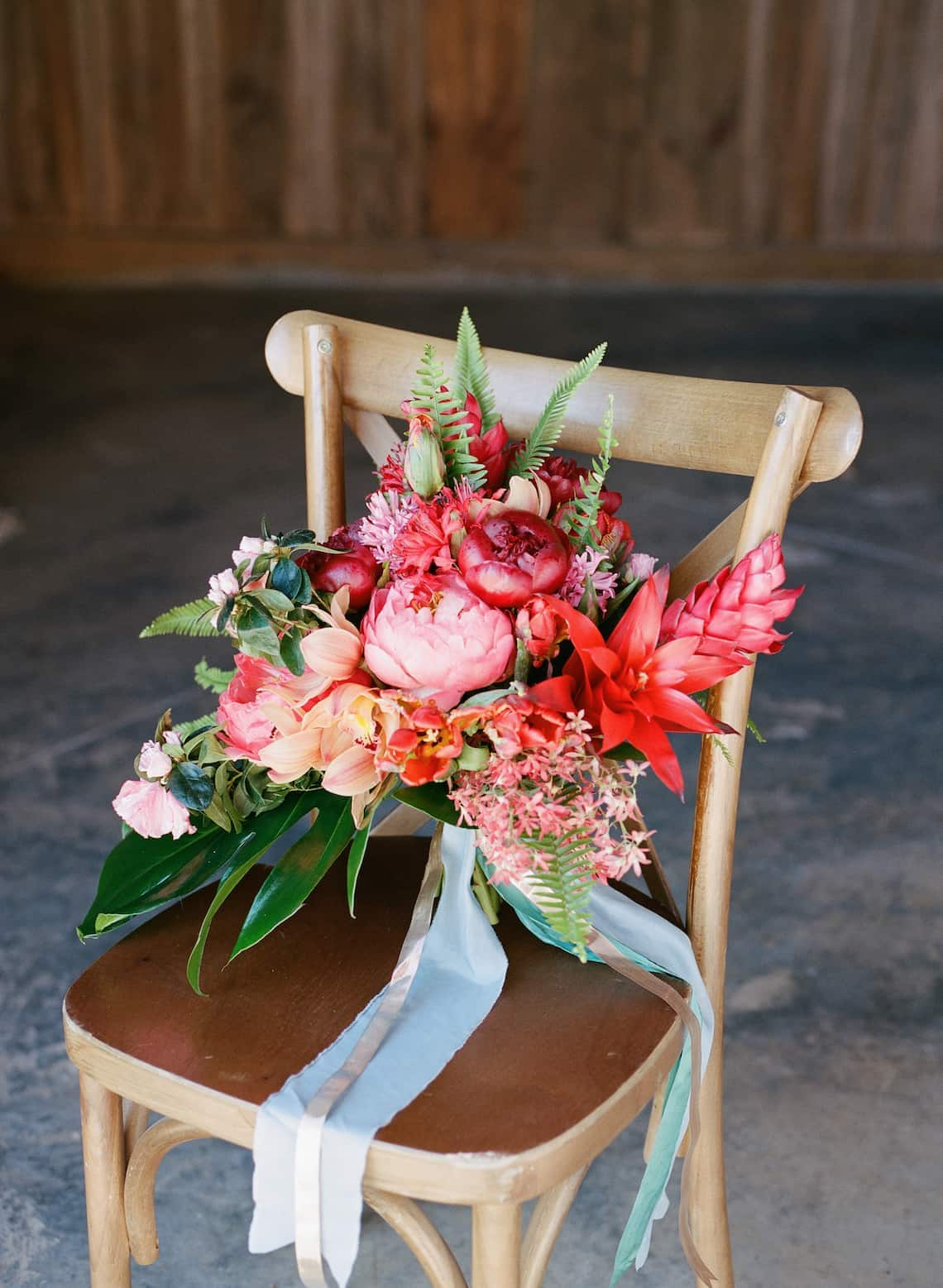 Modern Tropical Bouquet Sitting on a Chair