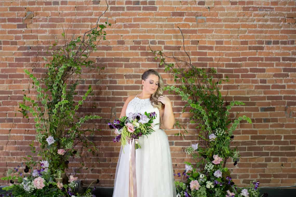 Bride with Natural Twig and Flower Wedding Arch