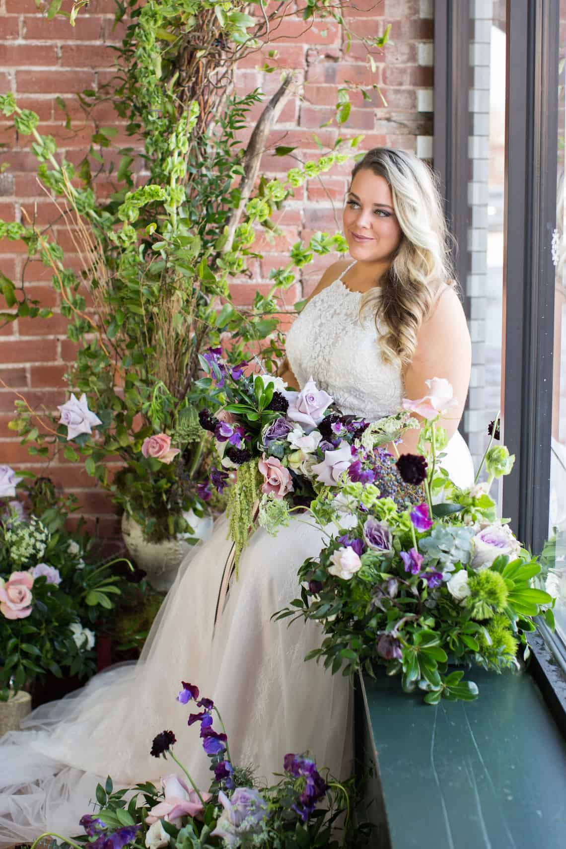 Bride Sitting Amongst Natural Greenery and Flowers