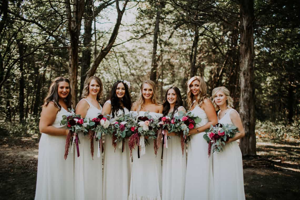 White Bridesmaids with Red and Pink Flowers