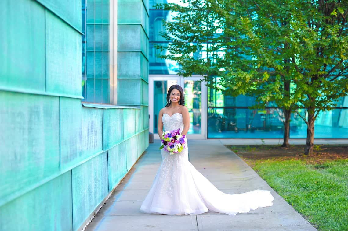 Lace Wedding Dress with Purple Bouquet