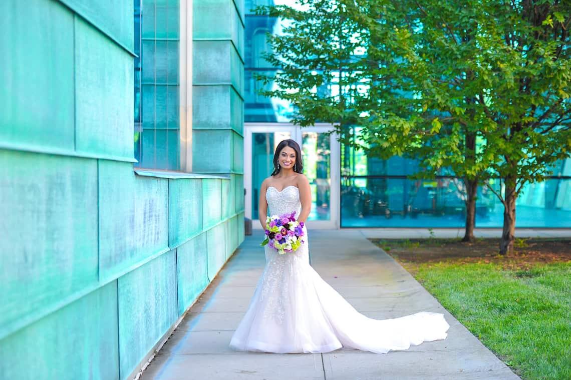 Lace Wedding Dress with Purple Bouquet