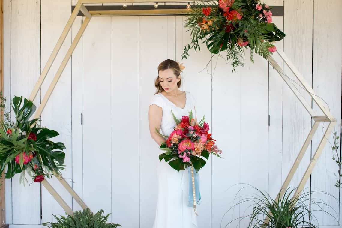Bride with Large Tropical Bouquet with Hexagon Arch