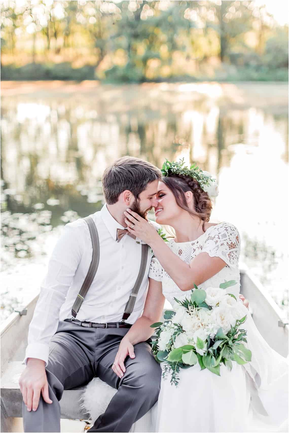 Bride and Groom Kissing in a Boat on a Small Lake