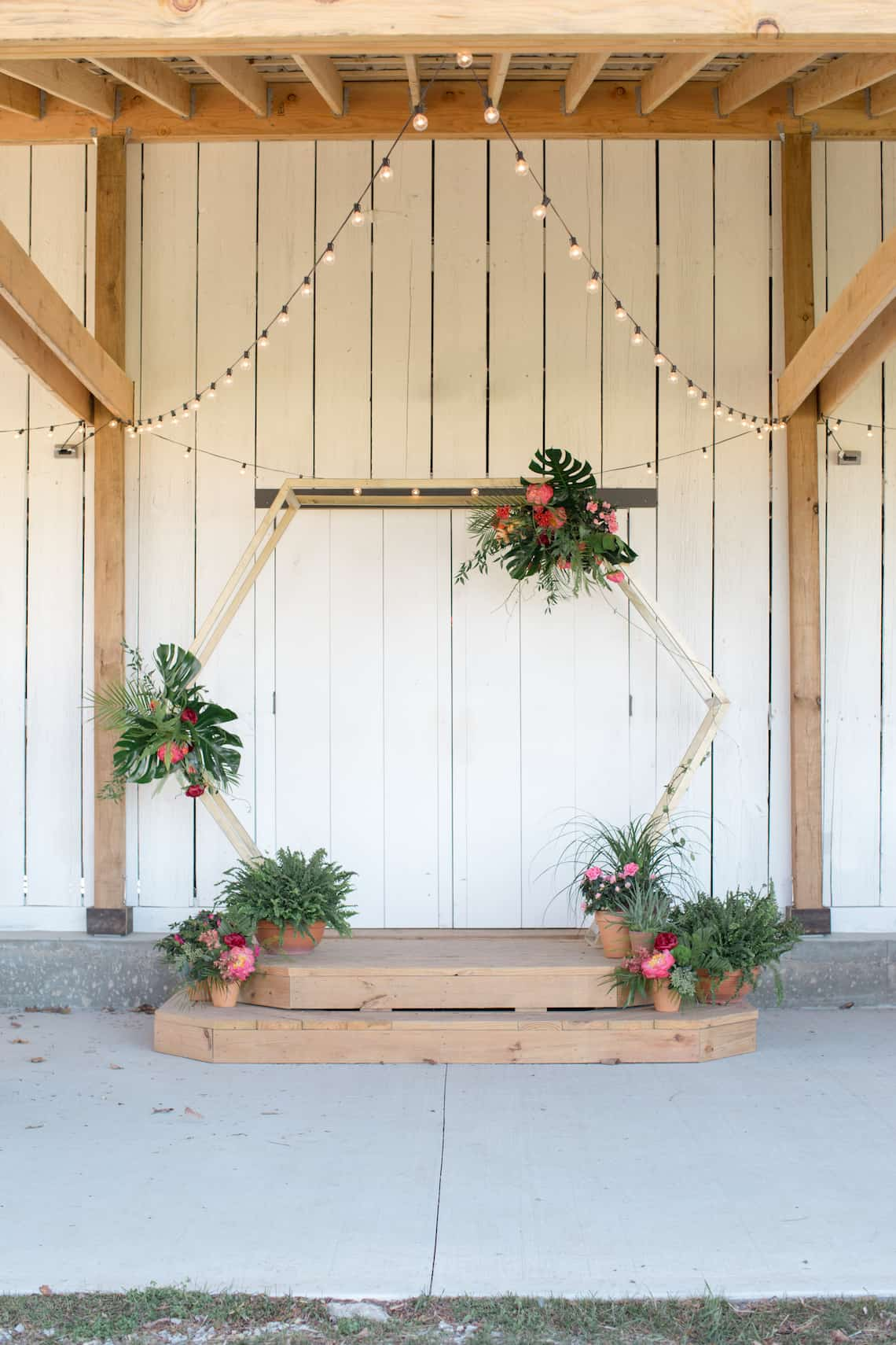 Gold Hexagon Arch with Tropical Flowers