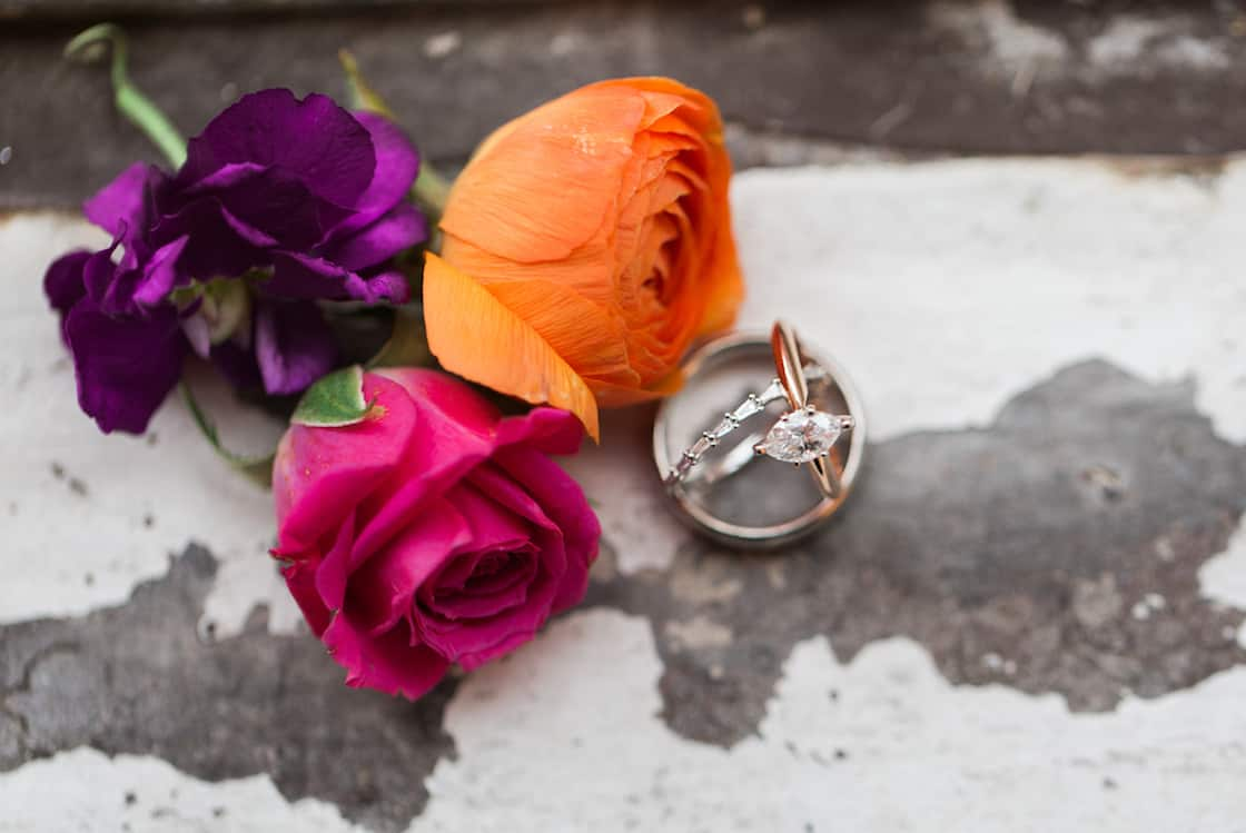 Wedding Ring Photo with Colorful Flowers
