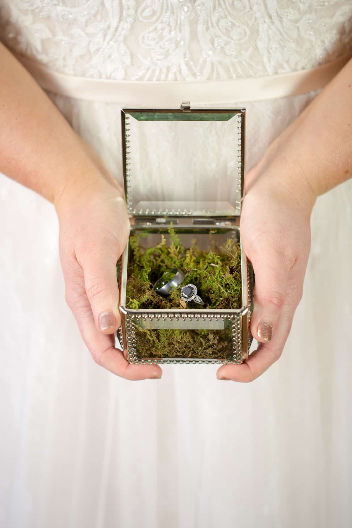 Wedding Rings in Glass Box with Moss