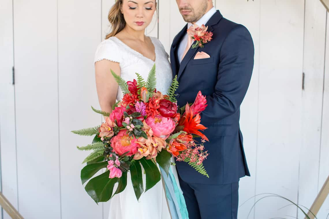 Bright and Bold Bridal Bouquet with Navy Dressed Groom